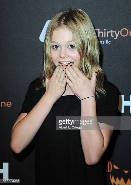 Actress Emily Alyn Lind arrives for the Los Angeles Haunted Hayride held at Griffith Park on October 9 2014 in Los Angeles California