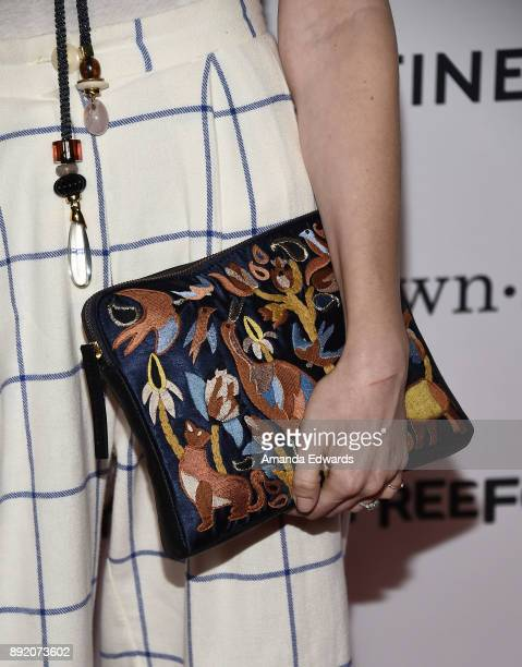 Actress Emily Arlook clutch detail arrives at the premiere of ABC's Grownish on December 13 2017 in Hollywood California