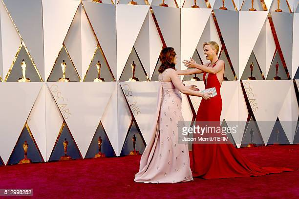 Actress Emily Blunt and Charlize Theron embrace at the 88th Annual Academy Awards at Hollywood Highland Center on February 28 2016 in Hollywood...