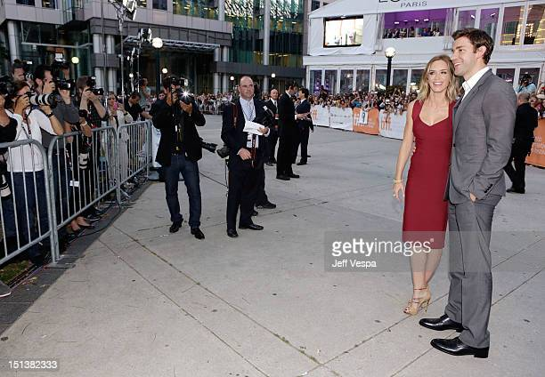 Actress Emily Blunt and husband actor John Krasinski attend the Looper opening night gala premiere during the 2012 Toronto International Film...