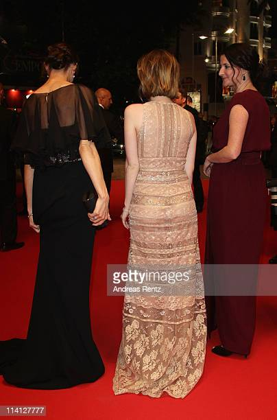 Actress Emily Browning departs with producer Jessica Brentnall and Director Julia Leigh after the 'Sleeping Beauty' premiere during the 64th Annual...
