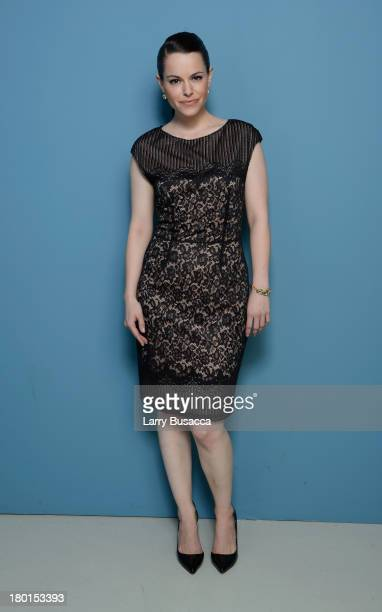 Actress Emily Hampshire of 'All The Wrong Reasons' poses at the Guess Portrait Studio during 2013 Toronto International Film Festival on September 9...