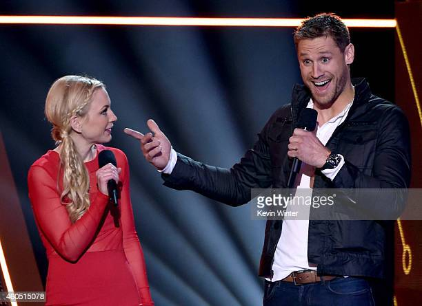 Actress Emily Kinney and recording artist Chase Rice speak onstage during the 2014 American Country Countdown Awards at Music City Center on December...