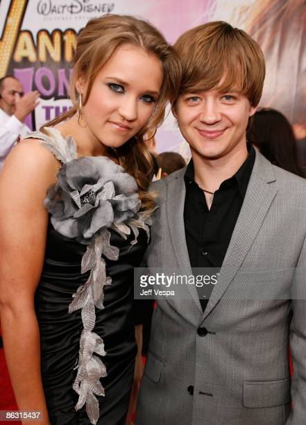 Actress Emily Osment and actor Jason Earles arrive at the premiere of Walt Disney Picture's Hannah Montana The Movie held at the El Captian Theatre...