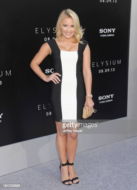 Actress Emily Osment arrives at the Los Angeles premiere of 'Elysium' at Regency Village Theatre on August 7 2013 in Westwood California