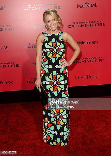 Actress Emily Osment arrives at the premiere of Lionsgate's 'The Hunger Games Catching Fire' at Nokia Theatre LA Live on November 18 2013 in Los...