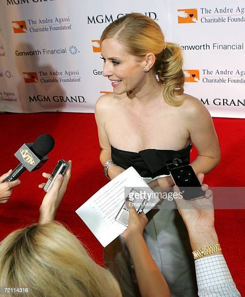 Actress Emily Procter is interviewed as she arrives at the 11th annual Andre Agassi Charitable Foundation's Grand Slam benefit concert at the MGM...