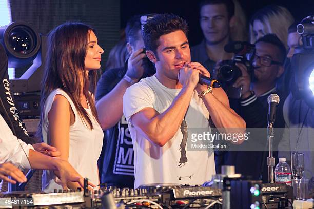 Actress Emily Ratajkowski and actor Zac Efron get on stage at We Are Your Friends tour afterparty on August 21 2015 in San Francisco California