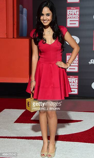 Actress Emily Tosta poses on arrival for the premiere of Disney's 'Big Hero 6' in Hollywood California on November 4 2014 The film opens in theaters...