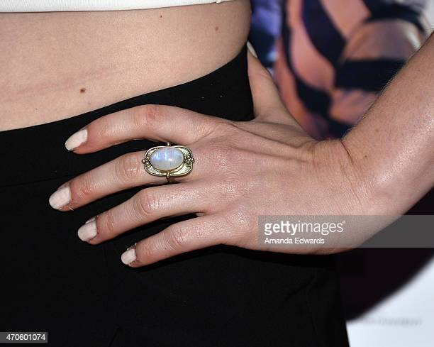 """Actress Emma Bell, ring detail, arrives at the Los Angeles premiere of """"See You In Valhalla"""" at the ArcLight Cinemas on April 21, 2015 in Hollywood,..."""