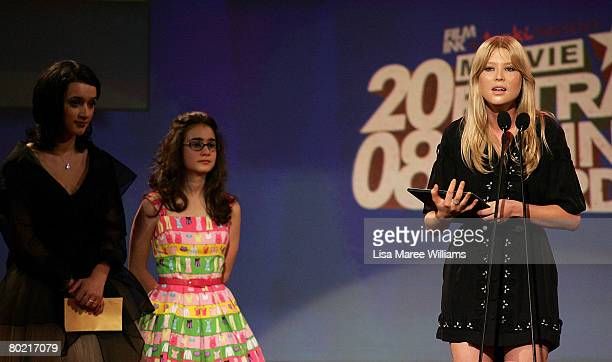 Actress Emma Booth accepts the award for 'Best Australian Newcomer' from actresses Keisha CastleHughes and Danielle Catanzariti on stage at the 2008...