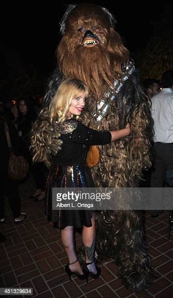 Actress Emma Julia Jacobs poses with Chewbacca at the After Party for the 40th Annual Saturn Awards held at on June 26 2014 in Burbank California
