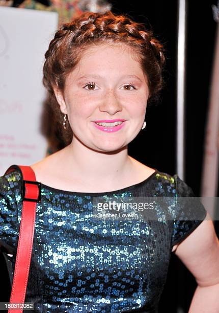 Actress Emma Kenney poses backstage at the Nanette Lepore fashion show during MercedesBenz Fashion Week Spring 2014 at The Stage at Lincoln Center on...