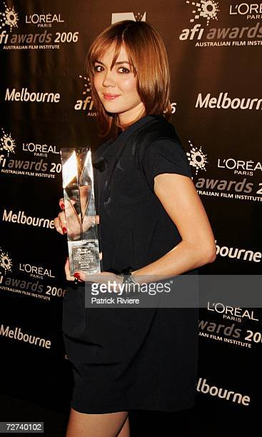 Actress Emma Lung poses in the awards room with the award for Outstanding Achievement in a Short Film Screen Craft at the L'Oreal Paris AFI 2006...