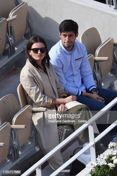 Actress Emma Mackey and a guest attend the 2019 French Tennis Open Day Fourteen at Roland Garros on June 08 2019 in Paris France