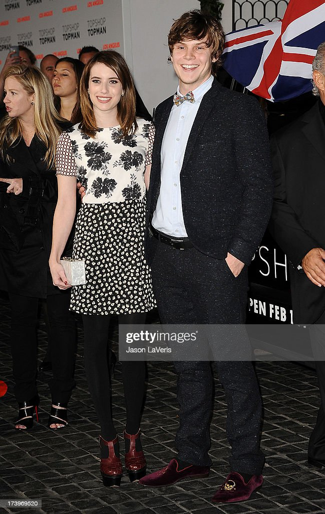 Actress Emma Roberts and actor Evan Peters attend the Topshop Topman LA flagship store opening party at Cecconi's Restaurant on February 13, 2013 in Los Angeles, California.
