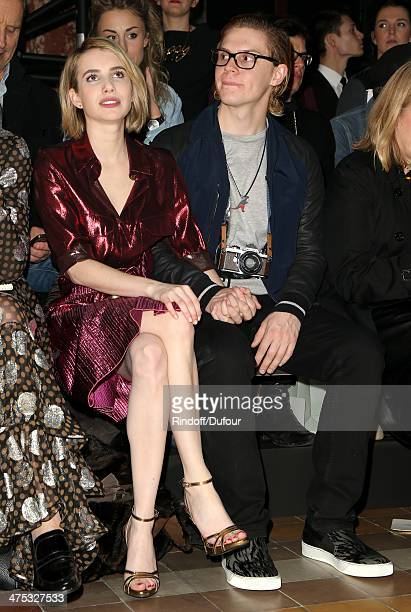 Actress Emma Roberts and Evan Peters attend the Lanvin show as part of the Paris Fashion Week Womenswear Fall/Winter 20142015 on February 27 2014 in...