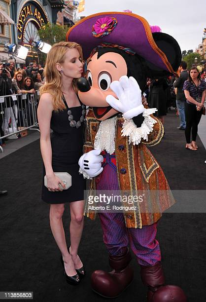 Actress Emma Roberts and Mickey Mouse arrive at the world premiere of 'Pirates Of The Caribbean On Stranger Tides' at Disneyland on May 7 2011 in...
