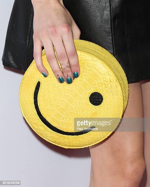 Actress Emma Roberts Handbag Detail attends the 3rd annual Airbnb Open Spotlight on November 19 2016 in Los Angeles California