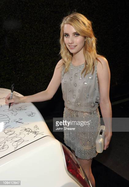 Actress Emma Roberts signs a Chrysler 300 at Vanity Fair Campaign Hollywood 2011 continues with the Richard Mille Toasts Fox Searchlight Films held...