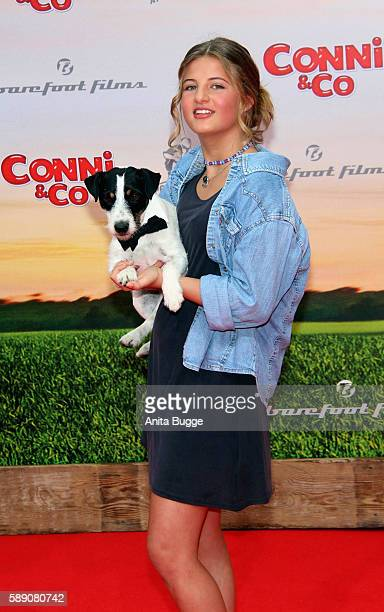 Actress Emma Schweiger and dog 'Frodo' attend the 'Conni Co' Berlin premiere on August 13 2016 in Berlin Germany