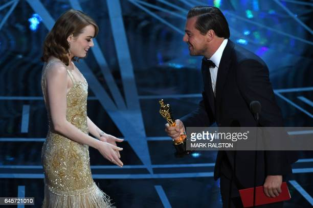 TOPSHOT US actress Emma Stone accepts the award for Best Actress award in 'La La Land' from US actor Leonardo DiCaprio on stage at the 89th Oscars on...