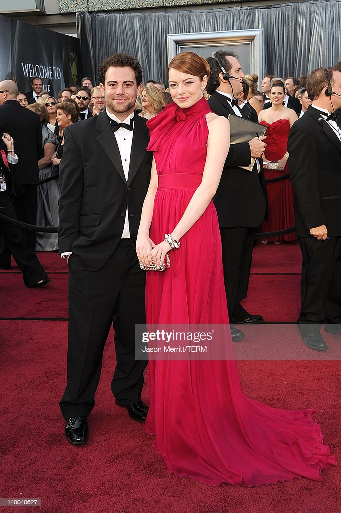 Actress Emma Stone (R) and guest arrive at the 84th Annual Academy Awards held at the Hollywood & Highland Center on February 26, 2012 in Hollywood, California.