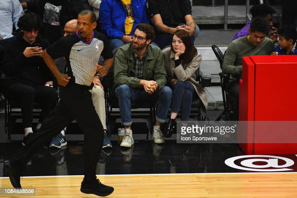 Actress Emma Stone and her boyfriend Dave McCary look on during a NBA game between the Golden State Warriors and the Los Angeles Clippers on January...