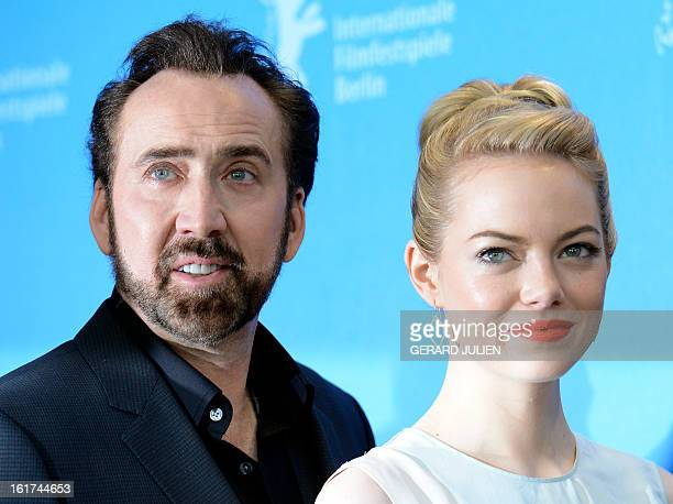US actress Emma Stone and US actor Nicolas Cage pose during a photocall for the film The Croods presented out of competition of the 63rd Berlin...
