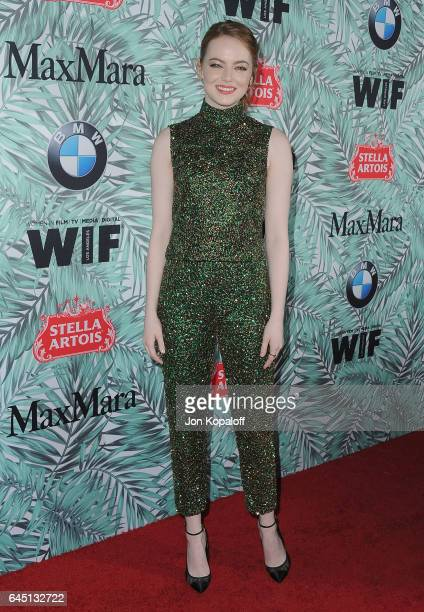 Actress Emma Stone arrives at the 10th Annual Women In Film PreOscar Cocktail Party at Nightingale Plaza on February 24 2017 in Los Angeles California