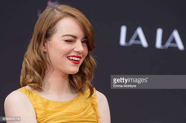 Actress Emma Stone attends 'Ryan Gosling and Emma Stone hand and footprint ceremony' at TCL Chinese Theatre IMAX on December 7 2016 in Hollywood...