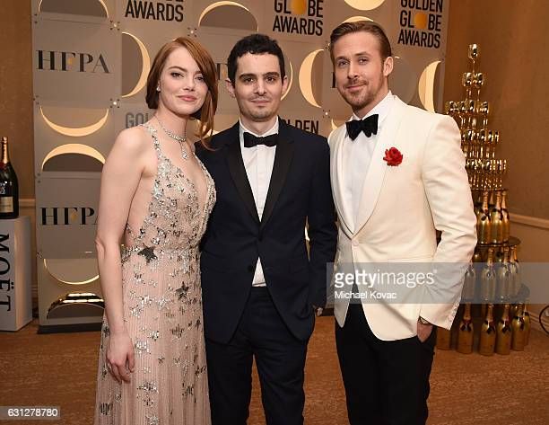 Actress Emma Stone director Damien Chazelle actor Ryan Gosling attend the 74th Annual Golden Globe Awards at The Beverly Hilton Hotel on January 8...