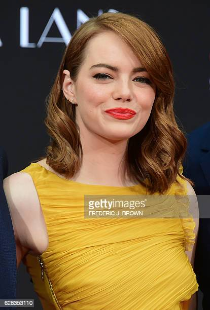 Actress Emma Stone poses at her Hand and Foot prints ceremony in front of the TCL Chinese Theater in Hollywood California on December 7 2016 ahead of...