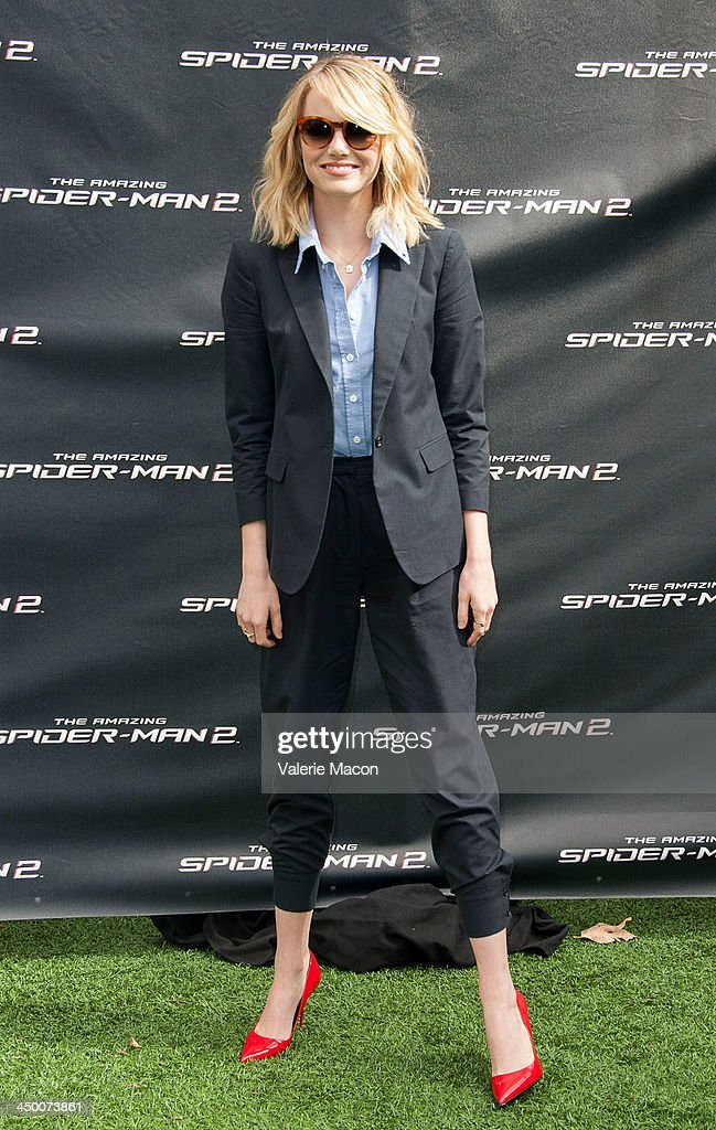 Actress Emma Stone poses at 'The Amazing Spiderman 2' Los Angeles Photo Call at Sony Pictures Studios on November 16, 2013 in Culver City, California.