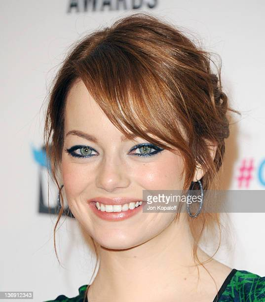 Actress Emma Stone poses in the press room at the 17th Annual Critics Choice Movie Awards at The Hollywood Palladium on January 12, 2012 in Los...