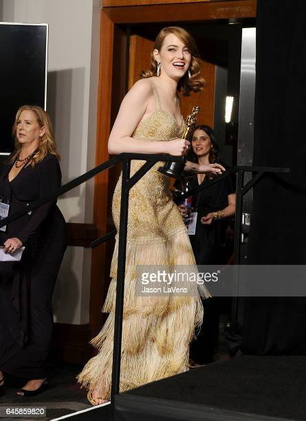 Actress Emma Stone poses in the press room at the 89th annual Academy Awards at Hollywood Highland Center on February 26 2017 in Hollywood California