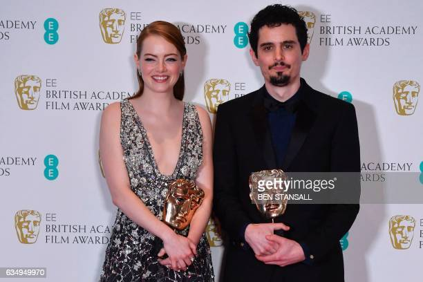 US actress Emma Stone poses with the award for a Leading Actress for her work on the film 'La La Land' and US director Damien Chazelle poses with the...