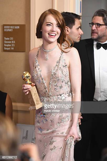 Actress Emma Stone winner of Best Actress in a Motion Picture Musical or Comedy for 'La La Land' walks into the press room during the 74th Annual...