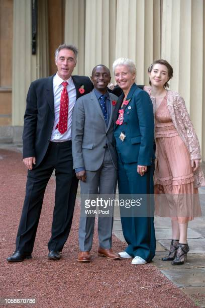Actress Emma Thompson with her husband Greg Wise and children Gaia Wise and Tindy Agaba leaves Buckingham Palace after she received her damehood at...