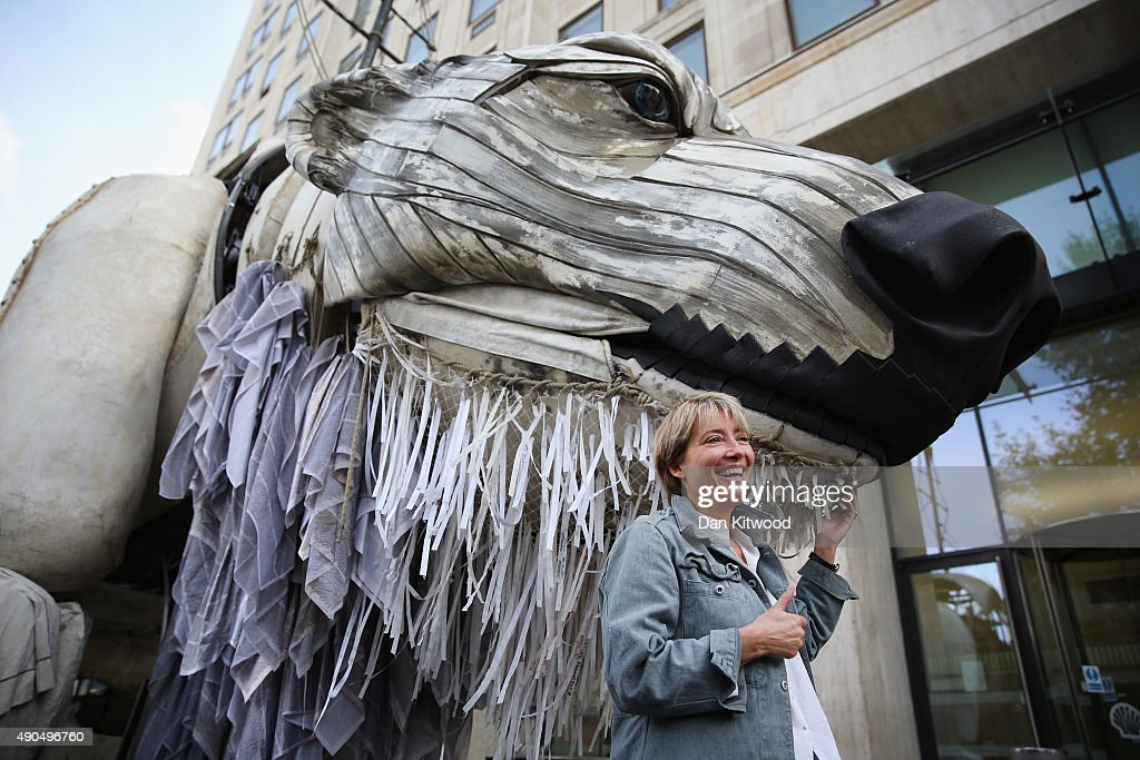 Actress Emma Thomson joins Greenpeace climate change activists outside the Shell building on September 29, 2015 in London, England. The event was marked as a celebration after the Anglo-Dutch oil company announced yesterday that it was pulling out of Arctic oil drilling. A giant model of a Polar Bear was then moved from its position outside Shell before being taken to Paris to join other activist activities.