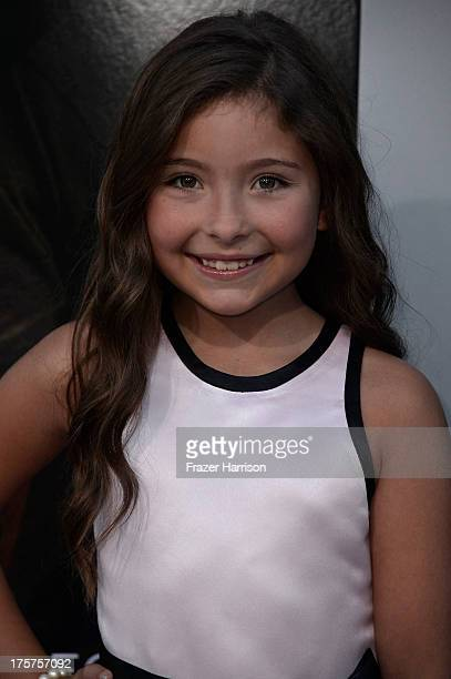 Actress Emma Tremblay arrives at the premiere of TriStar Pictures' Elysium at Regency Village Theatre on August 7 2013 in Westwood California