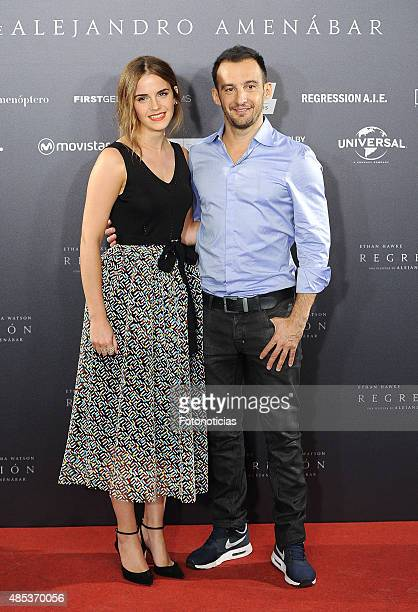 Actress Emma Watson and director Alejandro Amenabar attend a photocall for 'Regression' at the Villamagna Hotel on August 27 2015 in Madrid Spain