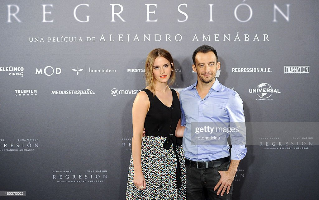 Actress Emma Watson and director Alejandro Amenabar attend a photocall for 'Regression' (Regresion) at the Villamagna Hotel on August 27, 2015 in Madrid, Spain.