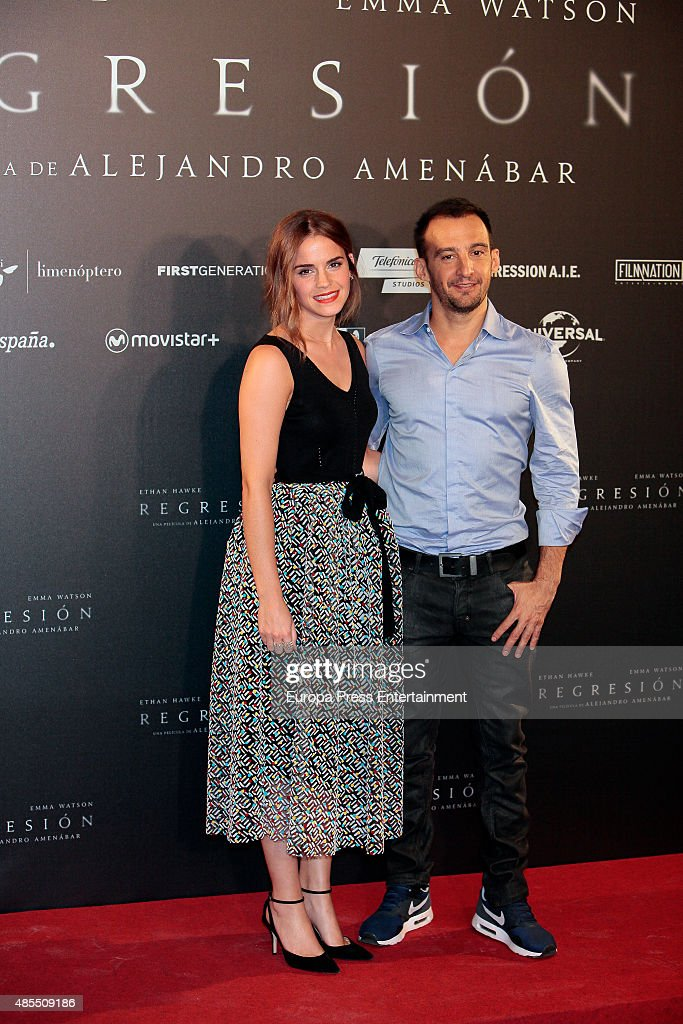 Actress Emma Watson and director Alejandro Amenabar attend 'Regression' photocall at Villamagna hotel on August 27, 2015 in Madrid, Spain.