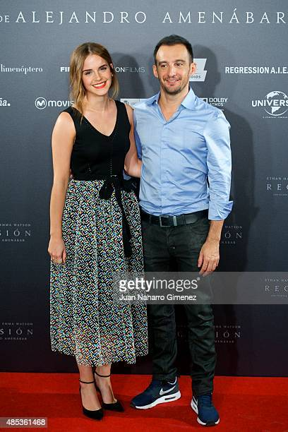 Actress Emma Watson and Director Alejandro Amenabar attend the 'Regression' photocall at Villamagna Hotel on August 27 2015 in Madrid Spain
