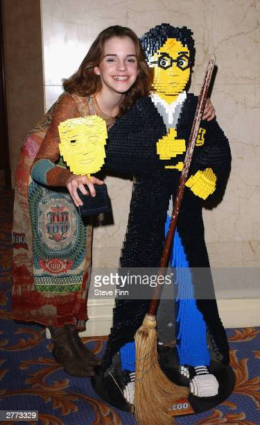 Actress Emma Watson and Harry Potter model pose in the pressroom at the British Academy Children's Film And Television Awards in association with The...