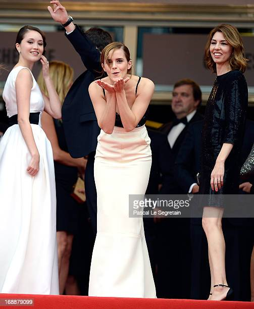 Actress Emma Watson blows a kiss as Katie Chang and Sophia Coppola look on prior to 'The Bling Ring' premiere during The 66th Annual Cannes Film...