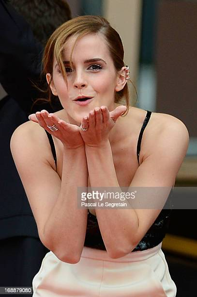 Actress Emma Watson blows a kiss as she attends 'The Bling Ring' premiere during The 66th Annual Cannes Film Festival at the Palais des Festivals on...
