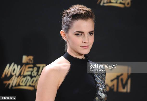 Actress Emma Watson poses in the press room at the 2017 MTV Movie and TV Awards at The Shrine Auditorium on May 7, 2017 in Los Angeles, California.