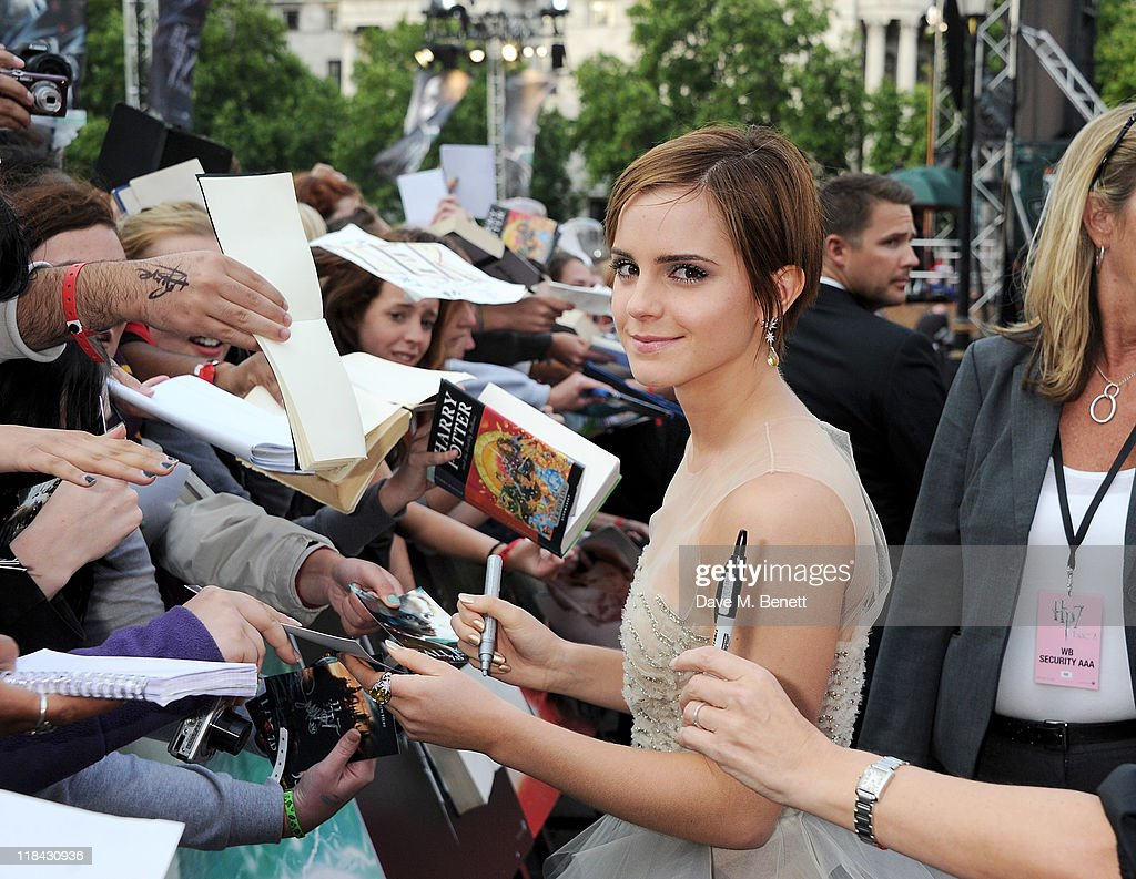 Actress Emma Watson signs autographs at the World Premiere of 'Harry Potter And The Deathly Hallows Part 2' in Trafalgar Square on July 7, 2011 in London, England.